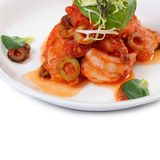 Shrimps in tomato sauce with olives Stock Photos