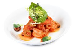 Shrimps in tomato sauce with olives. The shrimps in tomato sauce with olives Royalty Free Stock Image