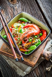 Shrimps with vegetables and noodles Stock Photos