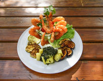 Shrimps with vegetables. Sea food Royalty Free Stock Image