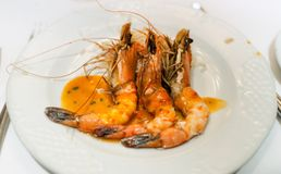 Shrimps on a white plate Stock Photos