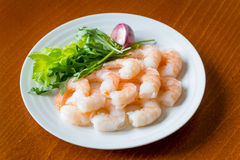 Shrimps. On a white plate with dressing Royalty Free Stock Photo