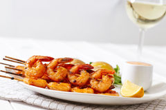 Shrimps on a white plate with potatoes Royalty Free Stock Photography