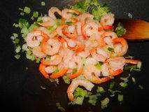 Shrimps in a wok. Shrimps cooking in a wok with vegetables Stock Images