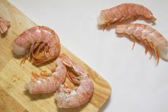 Shrimps on wooden board with copy space in centre Stock Photography