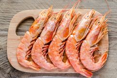Shrimps on the wooden board Royalty Free Stock Image