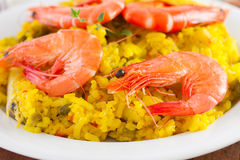 Shrimps with yellow rice Royalty Free Stock Image