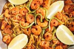Shrimps and zucchini noodles, close-up. Shrimps and zucchini noodles in pan, close-up, toned Stock Photos