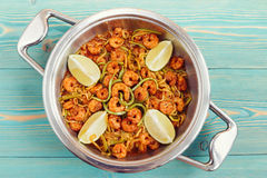 Shrimps and zucchini noodles in pan Stock Images