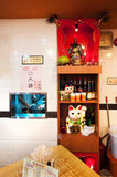 Shrine containing a statue of the Chinese God of War Guan Yu inside a Hong Kong restaurant. HONG KONG - OCT 13, 2013 - Shrine containing a statue of the Chinese Stock Photography