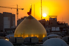 The shrine of Imam Hussein in Karbala. Karbala, Iraq – May 30 2014: The shrine of Imam Hussein, grandson of the Prophet Mohammed the Prophet of Islam, The Royalty Free Stock Photography