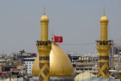 The shrine of Imam Hussein in Karbala. Karbala, Iraq – May 30 2014: The shrine of Imam Hussein, grandson of the Prophet Mohammed the Prophet of Islam, The Royalty Free Stock Image
