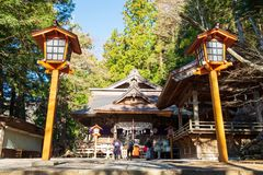 Shrine in Japan that is located in a forest where people come to pray royalty free stock photos