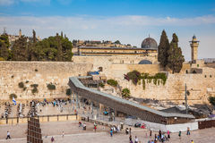 The shrine of Judaism. The area in front of the greatest shrine of Judaism. The Western Wall of the Temple is preparing for evening prayer.  Autumn holiday Royalty Free Stock Photos