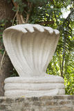 Shrine with large, white five-headed cobra statue of Shesha. Stock Photos