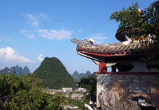 Shrine and pointy hills view. Small Chinese shrine above the Yangshuo and surrounding pointy hills stock photo