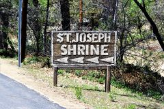 The Shrine of Saint Joseph of the Mountains, Yarnell, Arizona, United States. Sign at The Shrine of Saint Joseph of the Mountains located in Yarnell, Arizona stock photos