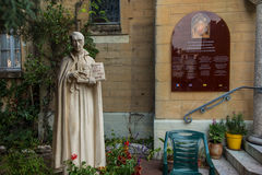 Shrine of St.. Claude de la Colombiere in Paray-le-Monial,. France. Figure St. Claudius set before the church Stock Photography