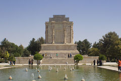 The shrine and the statue of poet Firdausi. Picture of mausoleum of poet Firdausi in the Iranian city of Mashhad, and the shrine was built on the Roman style Royalty Free Stock Photo