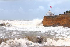 Shrine and temple on sea front. Shrine next to rough seas in india Royalty Free Stock Images