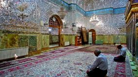 In Shrine of Yazd, Iran. YAZD, IRAN - OCTOBER 18, 2017: The muslims at pray in richly decorated Shrine of Imamzadeh Jafar, famous for its outstanding mirror stock footage