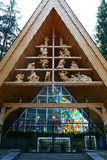 Shrine in Zakopane. A shrine showing Adam and Eve at the top through to the crucifixion with a stained glass on the back used by the late Pope John Paul II stock photos