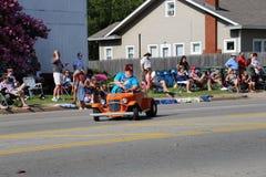 Shriner car at parade. Small car, parade, 4th of july edmond oklahoma 2014 hometown orange stock image