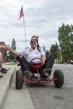 Shriner członka przejażdżki iść karta w paradzie Fotografia Royalty Free