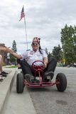 Shriner member drives go kart in parade. Royalty Free Stock Photography