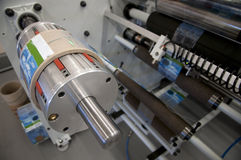 Shrink sleeve labeler machine. A shrink sleeve labeler is a machine designed to adhere shrink sleeve labels to a variety of containers such as PET bottles Royalty Free Stock Photo