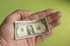 Shrinking_dollar-02 Stock Photos