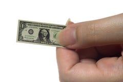 Shrinking dollar Royalty Free Stock Images