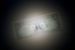 Shrinking dollar. Depiction of a shrinking United States dollar Royalty Free Stock Photos