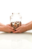 Shrinking value of retirement fund concept. With senior hands holding savings stock photography