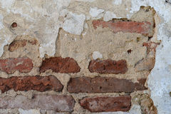 Shriveled old wall. Fragment of wall of an old church in a small village Stock Image