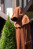 Shrouded Monk. Near tudor building Stock Photography