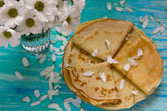 Shrove Tuesday, pancake day, Breakfast, top view, a bouquet of daisies Royalty Free Stock Photo
