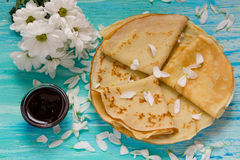 Shrove Tuesday, pancake day, Breakfast, top view, a bouquet of daisies Royalty Free Stock Images