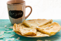 Shrove Tuesday, pancake day, Breakfast, top view, a bouquet of daisies Royalty Free Stock Photos
