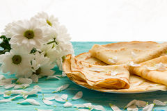 Shrove Tuesday, pancake day, Breakfast, top view, a bouquet of daisies Royalty Free Stock Image