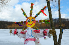Shrovetide doll on background of spring landscape Royalty Free Stock Photo