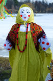 Shrovetide doll in colorful headscarf and sarafan Royalty Free Stock Photography