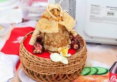 Shrovetide effigy made of pancakes close up. Appetizing fried pa Royalty Free Stock Image