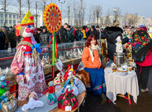 Shrovetide festivities. Exhibition Shrovetide dolls and pigeons Royalty Free Stock Photo