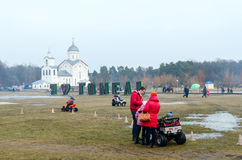 Shrovetide festivities in Gomel. Rent of children's electric car Royalty Free Stock Photography