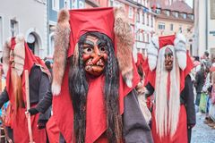 Shrovetide figure with red hood and fox tails. stock photos