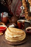 Shrovetide Maslenitsa Butter Week festival meal. Stack of russian pancakes blini. With red caviar, fresh sour cream and cranberry jam on the background of stock photography