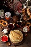 Shrovetide Maslenitsa Butter Week festival meal. Stack of russian pancakes blini. With red caviar, fresh sour cream and cranberry jam on the background of royalty free stock photo