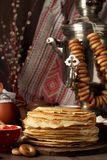 Shrovetide Maslenitsa Butter Week festival meal. Stack of russian pancakes blini. With red caviar, fresh sour cream and cranberry jam on the background of stock photos
