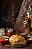 Shrovetide Maslenitsa Butter Week festival meal. Stack of russian pancakes blini. With red caviar, fresh sour cream and cranberry jam on the background of royalty free stock image